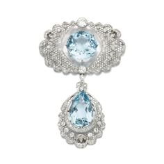 Aquamarine and diamond brooch/pendant, circa 1910 Of open work design, pierced and millegrain-set with a circular-cut and pear-shaped aquamarine weighing 30.45 and 26.17 carats respectively, circular- and single-cut diamonds, pendant detachable, brooch fittings, accompanied by fine link chain measuring approximately 360mm, fitted case stamped Collingwood Ltd., part illustrated.