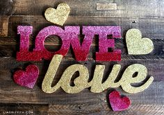 These #DIY glitter love banners add a fun pop to any Valentine's Day themed party #pinkdecor #lovebanners #valentines