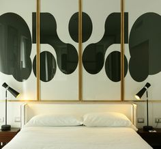 '70s art in Rome's Hotel Pulitzer -separate prints framed for a dramatic entryway (silver frames)