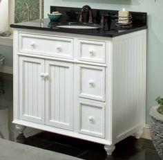 Bold turned feet and bead-board panels gives the Cottage Retreat Single Vanity the appeal of a beach-front cottage for your bathroom! Offering a Victorian style, this vanity features a lightly distressed white finish with inset sid