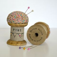 Handmade pincushion made using a vintage style wooden bobbin / cotton reel / spool decorated with applique, free motion embroidery and wording.