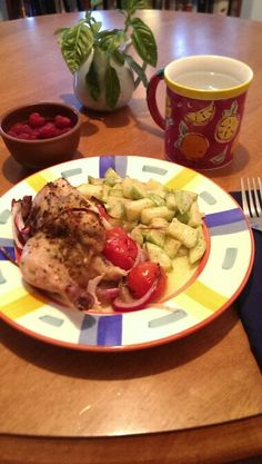 Cornish game hen roasted with tomatoes, onions, compound butter and Italian rub accompanied by sauteed zucchini and raspberries. I love summer cooking!