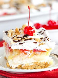 No Bake Banana Split Dessert is a classic! It layers a graham cracker crust, cream cheese-based filling, bananas, pineapple, strawberries, whipped cream, nuts, chocolate & a cherry on top!