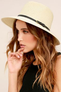 "Now is the time to make your getaway in the Adventure in Costa Rica Beige Straw Hat! A straw hat with a classic fedora shape and a black vegan leather band with buckle. 3"" brim and 23"" interior circumference."