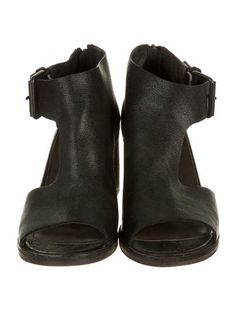 Black leather Marsèll booties with buckle closure at ankle strap and stacked block heels. Includes box and dust bag.