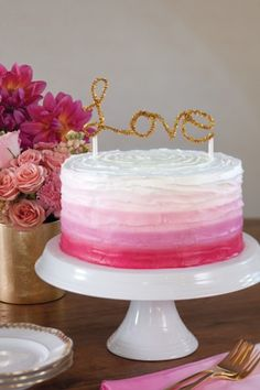 "A Valentine's Dinner | Ombre cake with a gold ""love"" topper"