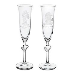 Share a romantic toast with our pair of Minnie and Mickey Glass Flutes. Created by Arribas, this elegant stemware features etched art of Bride Minnie on one glass and Groom Mickey on the other. Personalize for a perfect wedding gift.