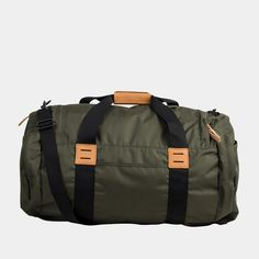 United By Blue's Olive 55L Arc Duffel is the perfect, carry-on friendly bag to get you and all of your gear from place to place with pockets for sunglasses, not