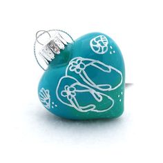 Flip Flops Heart Ornament Beach Decor - Beach Wedding Gift - Doodle Art - Hand Painted Glass - Turquoise White Silver - Seashells Ornaments by CreationsByJDB.  Flip Flops Beach Heart Ornament would make a great beach wedding gift or beach house decor.  This glass heart ornament is hand painted on the inside in shades of turquoise green and drawn on the outside in doodle style with white paint marker.  Pin this to your wedding gift idea board.