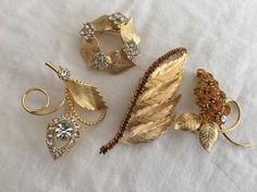 Vintage Costume Jewelry, Lot of 4 gold tone and rhinestone brooches #unknown
