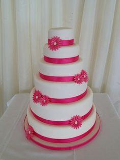 hot pink gerbera wedding cake alternate hot pink and lime green ribbon purple flowers