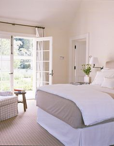 Barefoot Contessa - Barn - Ina Garten - House Beautiful. French doors open to the gardens outside from the bedroom and give the quiet sitting area a great view.