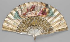 """1862, England - Fan - Painted and gilded paper leaf. Obverse: center scene of """"His Majesty George III, with Queen Charlotte and the Royal Family"""", floral motifs at borders and sides. Gilded paper binding. Carved mother-of-pearl sticks with gilded scenes of man and woman (center blades), woman on obverse guard, man on reverse gurad, floral motifs. Mother-of-pearl rings on rivet. Brass rings set with six red stones."""