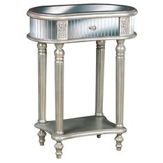 Bring elegance to your home by adding this elegant painted accent table. Delight in the carved detailing along each leg and the silver hardware that completes the pull-out drawer. It also includes a bottom shelf that offers additional storage space.