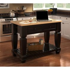 With all the added space this kitchen island provides, you're free to cook up something big. Store knives and other kitchenware in the two gliding metal drawers. This spacious kitchen island with plen