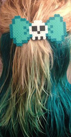 Hey, I found this really awesome Etsy listing at https://www.etsy.com/listing/195618674/perler-bead-skull-hairbow