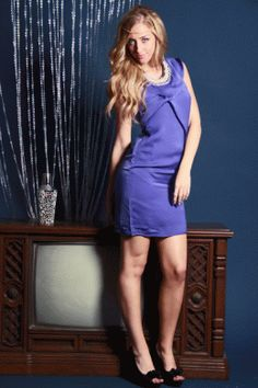 This very stylish dress. Featuring soft silk like fabric, ruffle accent printed one straps, side zipper closure. and attached inner lining. 100% Polyester