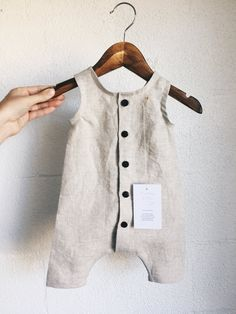 Our top selling romper is handmade to last and makes the perfect gift for any occasion. Unlined with our light weight chai linen, matching binding around arm an
