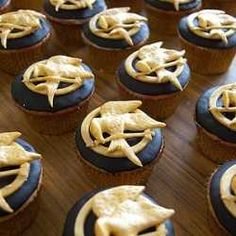 Promotional Cupcakes For The Hunger Games Adventures With Mockingjay Pins.