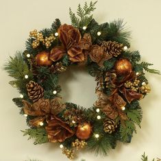 green Christmas Wreath with brown flowers and golden baubles also golden pine cones. Decorating Christmas Wreaths With Ribbon Brings Inspiration Design Outdoor Christmas Wreaths, Artificial Christmas Wreaths, Christmas Door Decorations, Xmas Wreaths, Christmas Reef, Noel Christmas, All Things Christmas, Christmas Crafts, Christmas Ornaments