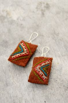 Ethnic woolen textile earrings. Rustic orange textile by Mioltu