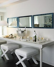 The frames of these rectangular mirrors are smartly outfitted in midnight-blue velvet ribbon.