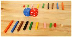 Juego de mesa con regletas: capturar regletas -Se suman o restan dados y se le quita la regleta al contrario.