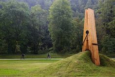 Mehmet Ali Uysal, a professor of art at Middle East Technical University created this giant clothespin sculpture. It was built for the Festival of the Five Seasons in Chaudfontaine Park, which appears to be in a town on the outskirts of Liège, Belgium.