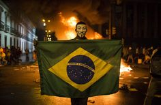 AP Photo/Felipe Dana A demonstrator holds a Brazilian flag in front of a burning barricade during a protest in Rio de Janeiro, on June . Brazil Protests, Brazil World Cup, V For Vendetta, Vendetta Mask, Protest Signs, Powerful Images, Military Police, Photojournalism, Picture Photo