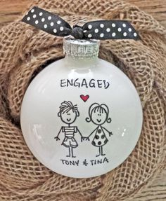 PERSONALIZED ENGAGEMENT ORNAMENT: This adorable hand painted engagement ornament can be personalized with the couples first names on the front and 2016 on the back. Girls are dressed in polka dots and boys are in a striped shirt. Makes a one-of-a-kind keepsake that is truly unique! PERSONALIZATION INFO: ***Please provide the following...***  1. Names in order of appearance (starting with guy) Example: Guy - Tony Girl - Tina (2016 will be included on back unless full date is specified)  EACH…
