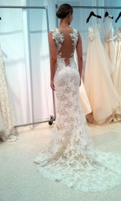 "Amsale also showed lace with the subtlest pop of color in the lining. ""Flesh, buff, mocha -- every designer calls their colors something different."" The effect is undeniably sexy; this isn't your grandmother's lace wedding gown.."