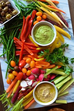 A big messy vegetable board makes for an easy, attractive, and healthy party appetizer. Choose a variety of colorful seasonal vegetables and serve with creative dip options. It's a wonderful alternative to the typical crudite platter or cheese board.