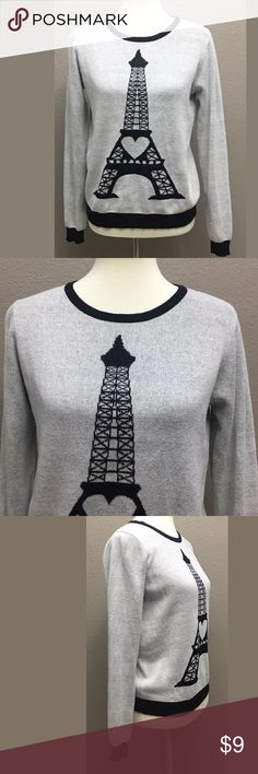 Forever 21 Eiffel Tower Sweater, Size Medium Gray and Black Eiffel Tower soft Sweater by Forever 21 in good preowned condition  Fabric 55% Cotton And 45% Acrylic  Button down the back  MEASUREMENTS (Taken Flat Lay): shoulder to shoulder 15 inches. Chest armpit to armpit 19 inches. Length 24 inches. Sleeve length about 25 inches.  Arrives clean and ready to wear from a smoke free environment Forever 21 Sweaters