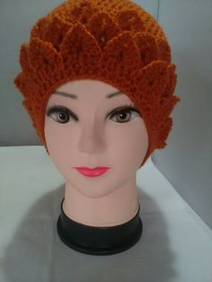 A lovely slightly slouchy hat in burnt orange colour. It has three rows of crocodile stitch around the bottom edge. Crochet Beanie Hat, Slouchy Hat, Beanie Hats, Crochet Hats, Crocodile Stitch, Flower Spray, Burnt Orange Color, Holly Berries, Hand Crochet