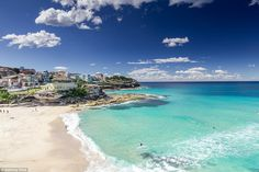 With crystal blue water, beautiful yellow sand and colourful houses dotted around, Bondi B...