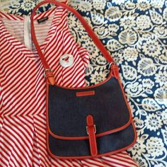 Vtg Denim Red Leather 80's Dooney & Bourke Purse This bag is a rare find. It has never been used and is in perfect condition. I will put up an additional listing with extra pics.  Bag is Saddle style made if heavy dark denim and red leather trim with heavy stitching. Each buckle is marked brass. Dooney and Bourke red, white, & blue stitched in cloth label with serial number printed on back. Red strap in front has stitched in velcro closure. Weird but velcro had just been invented. Inside…