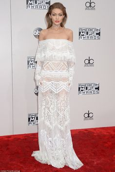 Hostess with the mostess! Gigi Hadid, 21, was a vision in white lace at the American Music Awards in Los Angeles on Sunday