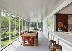Modern porch on 18th century house by O'Neill Rose, Hidden Hollow, Remodelista