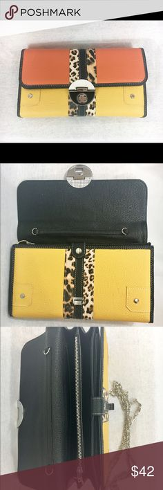 Double-Toned Snap Clutch/Purse Multiple compartments Leopard Printed Strip & Buckle Snaps closed  Includes chain-style shoulder strap Bags Clutches & Wristlets