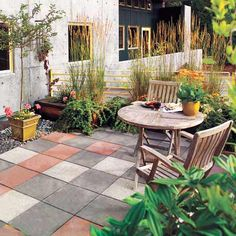 Precast concrete slabs in terra-cotta, charcoal, and soft gray give this patio its distinctive checkerboard look. For a new installation, purchase slabs like these that are tinted during the manufacturing process. Or to liven up existing monotone slabs, you can brush, trowel, or squeegee on a thin layer of Quikrete's DIY-friendly concrete resurfacer (find it at The Home Depot). | Photo: Norm Plate | thisoldhouse.com