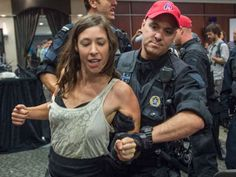 National Energy Board cancels first day of Energy East hearings in Montreal after protests - A demonstrator is taken away by a police officer after disrupting the National Energy Board public hearing into the proposed $15.7-billion Energy East pipeline project proposed by TransCanada Monday, August 29, 2016 in Montreal. (Paul Chiasson/The Canadian press)