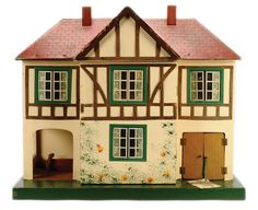 Triang wooden Dolls House, British, 1950's, opening at front to reveal 2 rooms on 2 storeys, metal framed windows, sun porch to left and garage to right. LOVE!