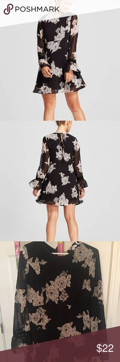 Black floral dress NWOT- only worn to try on. Sleeves are sheer, has 3 bow ties up the back with a zipper on the side. Super cute! No trades. Price is firm Xhilaration Dresses Mini