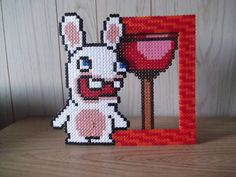 Perler bead picture frame I forgot what video game the rabbit is in but is still a fun perler frame to make