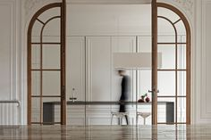 white walls, double doors, white cabinetry