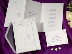 Wedding Invitations: Stand together on your invitation as you will stand together on your wedding day.  With beautiful roses given a hint of purple, pick your liner and inks to customize this just for the two of you!