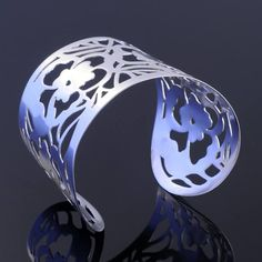 Sterling silver cuff bracelet, commissioned by a lovely lady in Buckingham. This is an entirely unique design featuring pansies which are her favourite flower. Alexandra Buckle