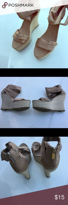 Wedge hills Satiny Champagne color worn a few times mostly been in storage with other shoes.  Sexy on the feet few marks on the edge of the wedge and little on the ankle. Lot of life feel free to make an offer. Jennifer Lopez Shoes Platforms