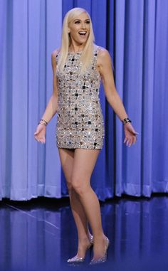 Let's Disco from Fashion Police Gwen Stefani shimmers like a true human disco ball on The Tonight Show Starring Jimmy Fallon in a metallic KaufmanFranco cutout mini dress with sparkly Jimmy Choo pumps. Now, let's see those dance moves! Gwen Stefani Legs, Gwen Stefani And Blake, Gwen Stefani Style, Short Silver Dress, Gwen Stefani Pictures, Gwen And Blake, Sparkly Mini Dress, Sexy Legs And Heels, Jimmy Choo