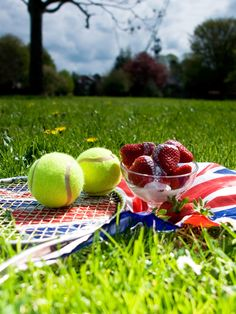 Green grass ,Yellow balls,Purple background,Players in White...Yeah baby it's Wimbledon time!